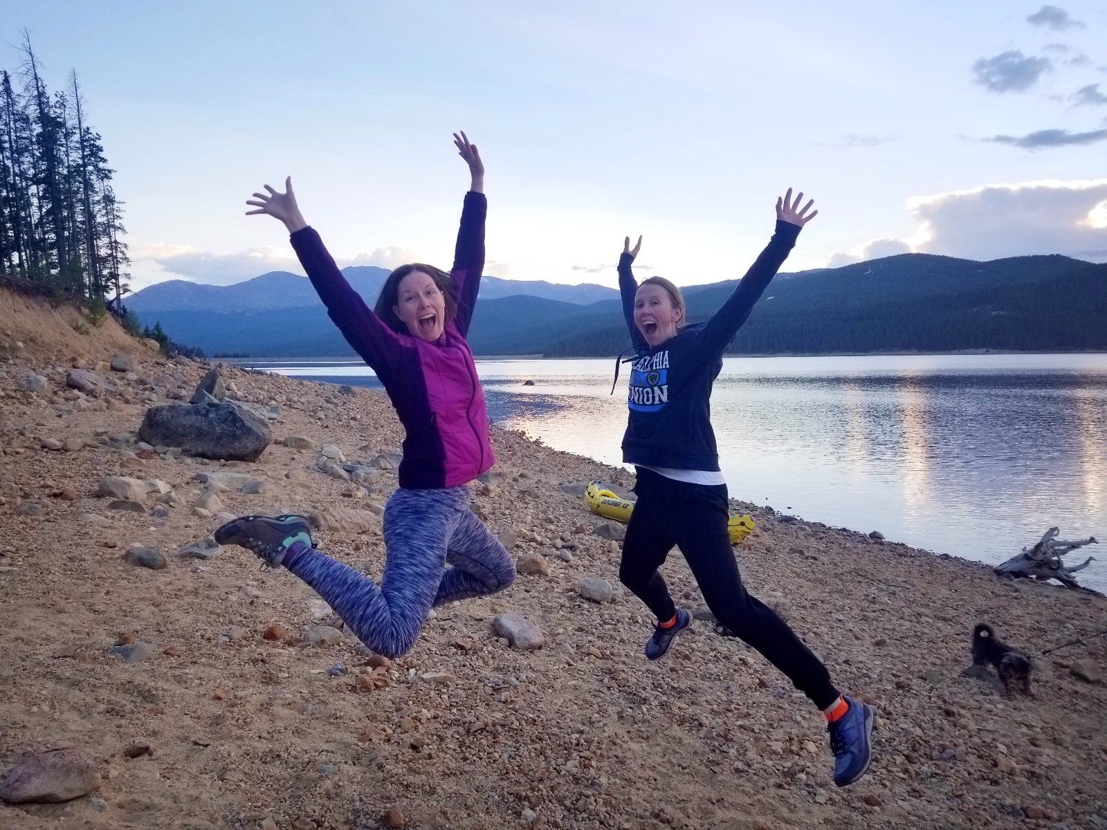 Jumping for joy at chilly Turquoise Lake at sunset