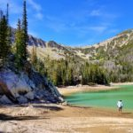 Jimmy stepping into Bell Lake's green water