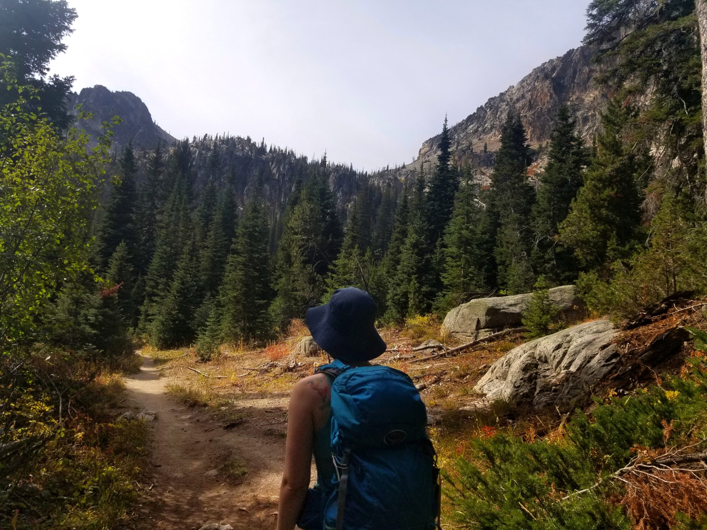 Sarah hiking through Fall colors in the Sawtooth Mountains
