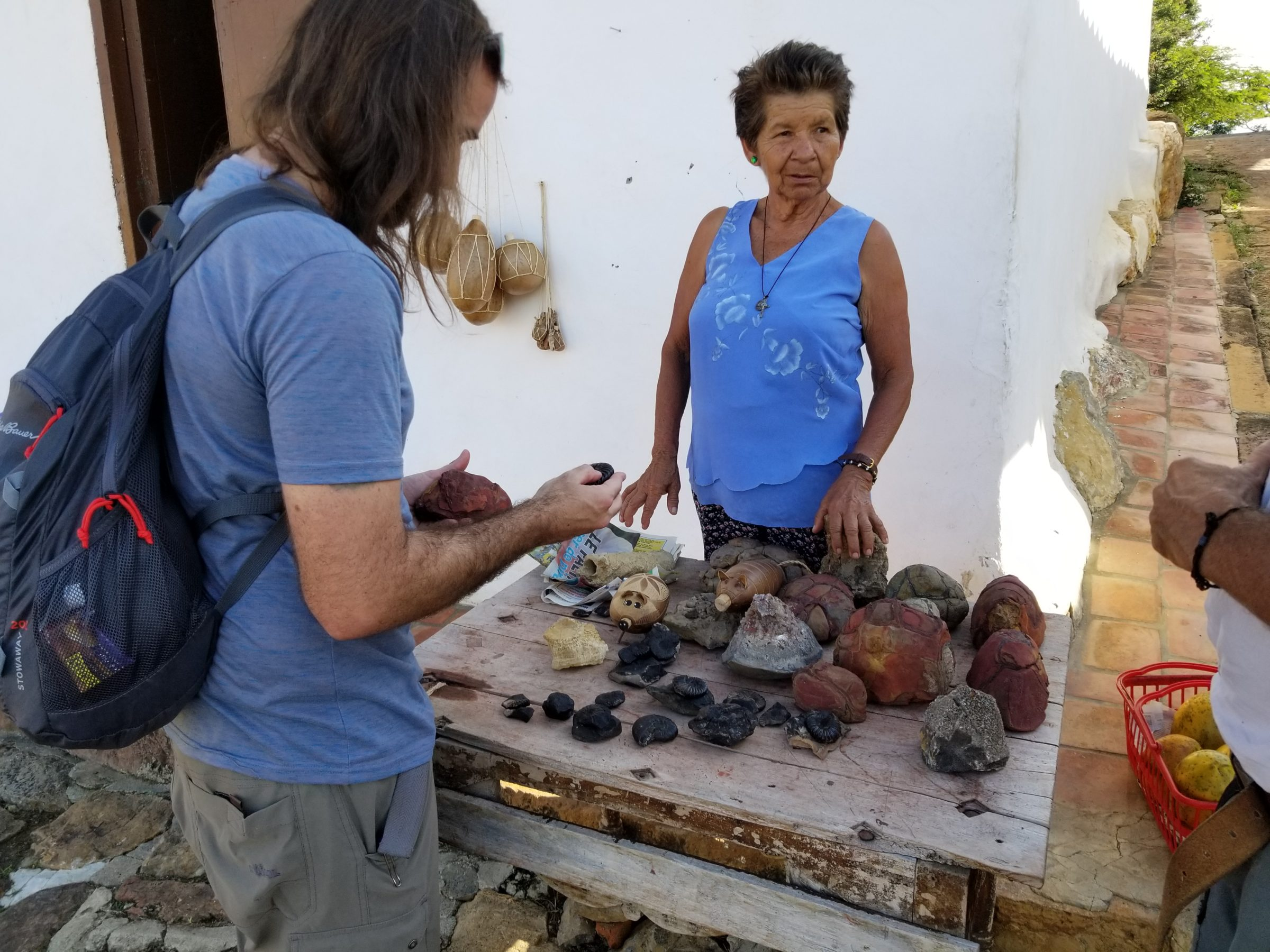 Jimmy fossil-shopping from a local in Guane