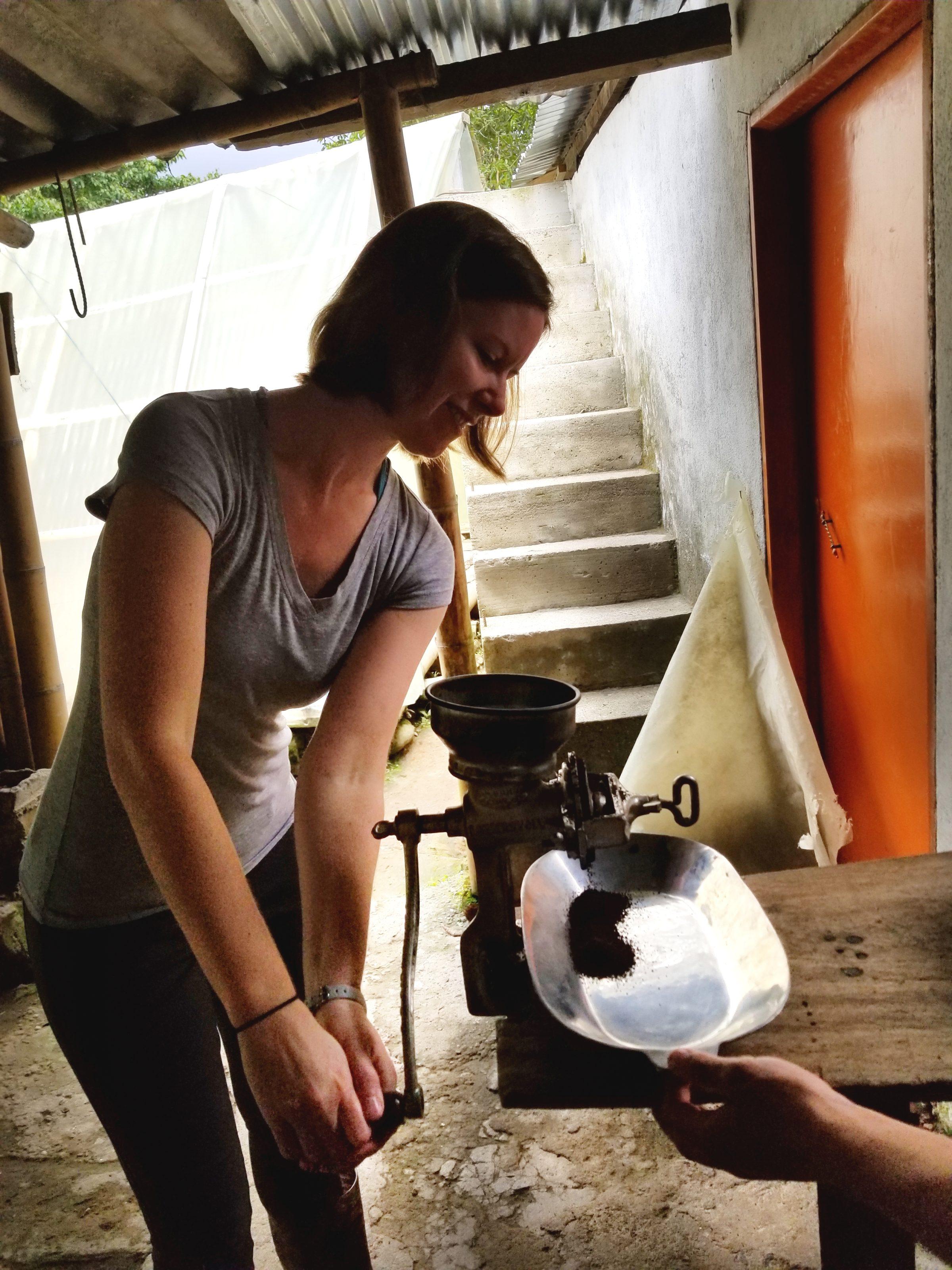 Sarah grinding coffee