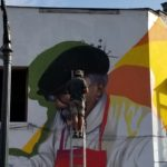 Artist creating a massive mural in Santiago Chile